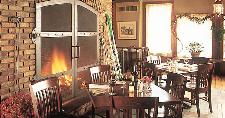 dining tables set up by a fire in the restaurant