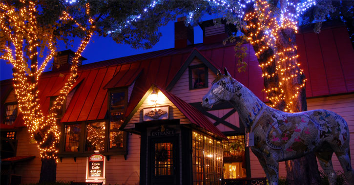 the outside of Longfellows at night with lights