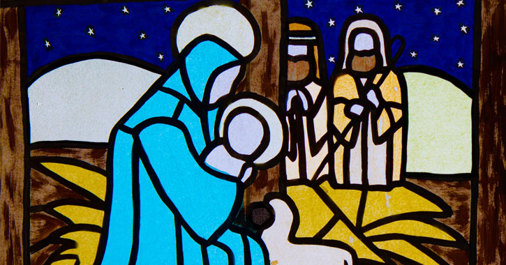 stained glass version of manger scene