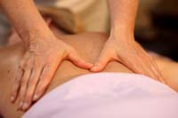 hands massaging womans back