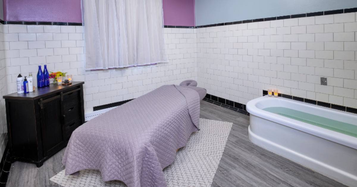 spa room with bed and bath tub