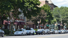 a street in Saratoga with cars lined up