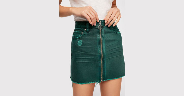 close up of a tealish zip up mini skirt