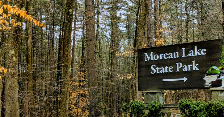 a sign for Moreau Lake State Park