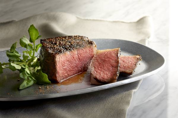 pieces of steak on a silver plate