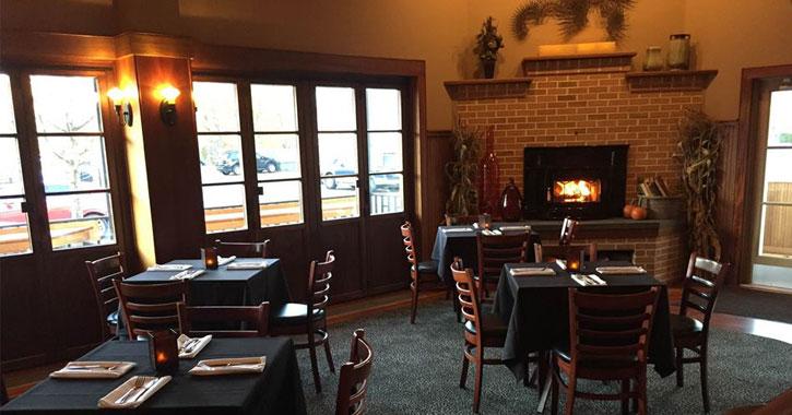 a fire in a fierplace in a restaurant