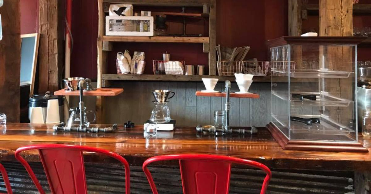 stools at a counter inside nomad coffee and crepes