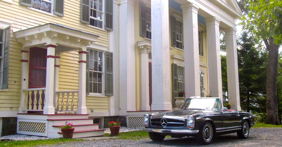 a car parked in front of the mansion