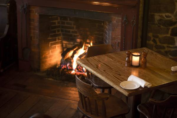 dinner table by a fireplace