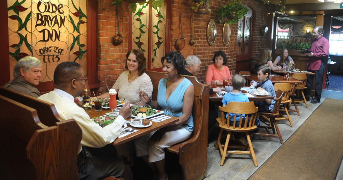 adults and kids eating at olde bryan inn