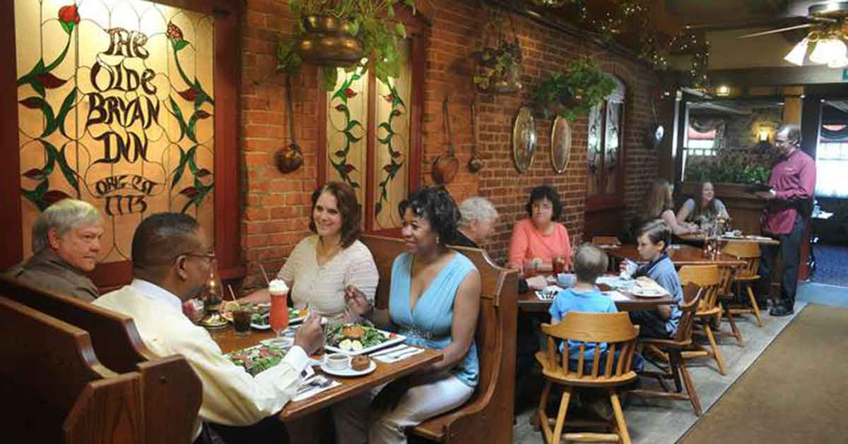 people eating inside the olde bryan inn