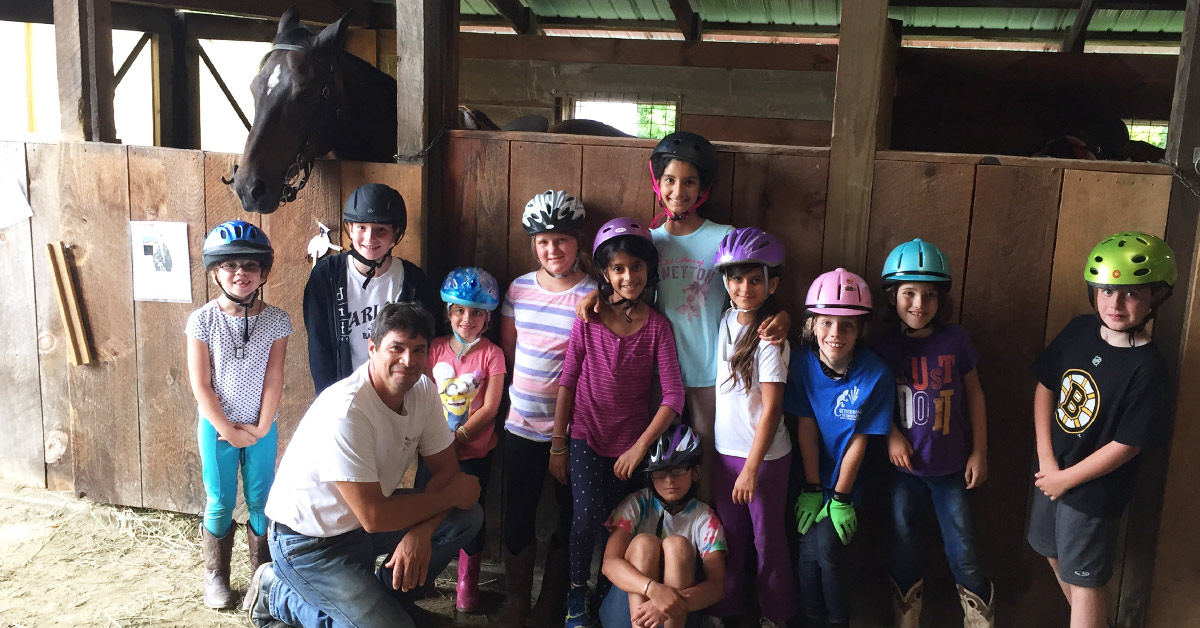 group of kids at a horseback riding party