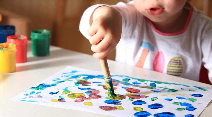 close up of a child painting