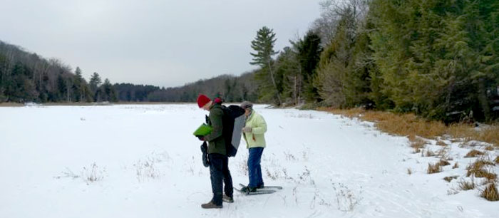 people snowshoeing at the palmertown conservation area