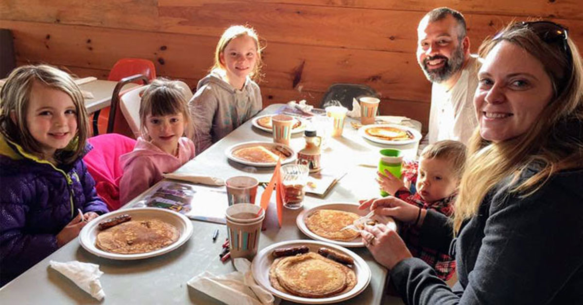 a family pancake breakfast in a restaurant