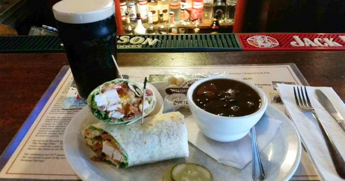wrap on plate, and beer and baked beans nearby