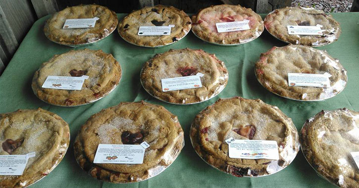 a display of multiple fruit pies