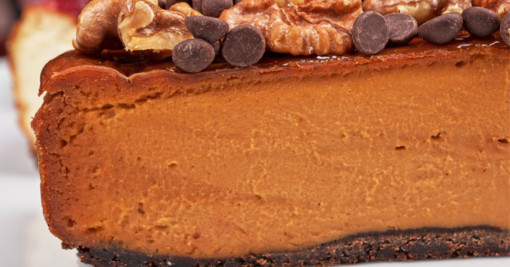 close up of a slice of pumpkin cheesecake