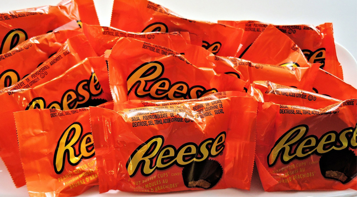 several packages of full sized Reese's Peanut Butter Cups
