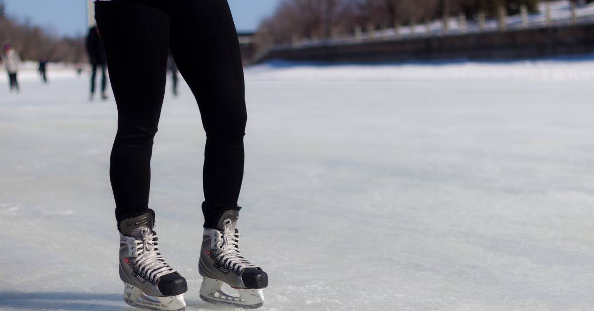 person wearing black pants and ice skates