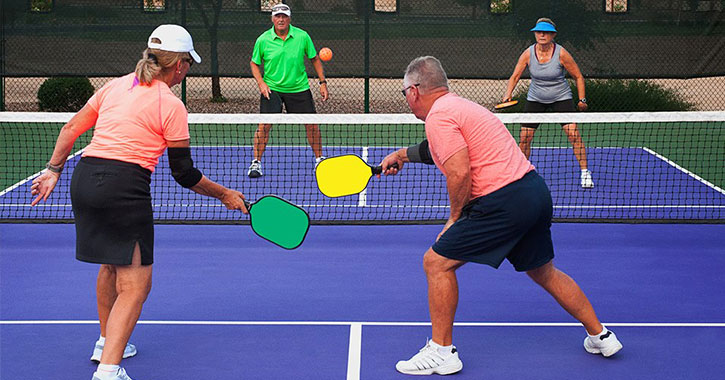 people playing pickleball outdoors