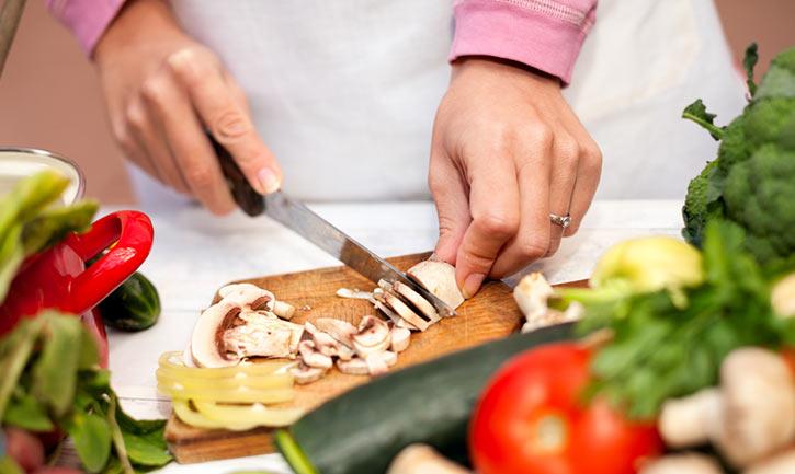 hands cutting mushroom