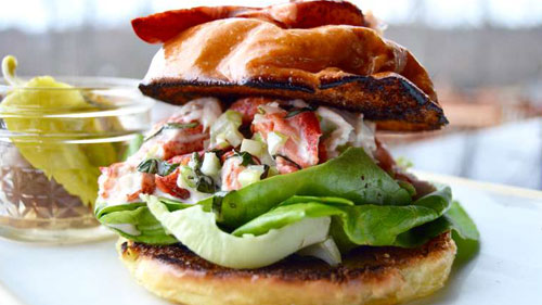 an elegant looking seafood burger