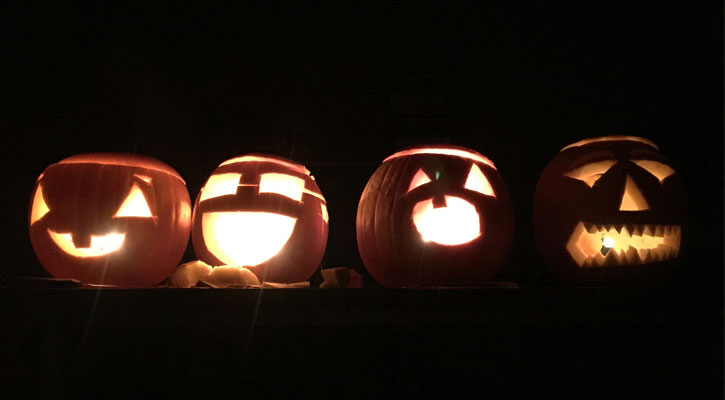 four jack-o-lanterns in a row