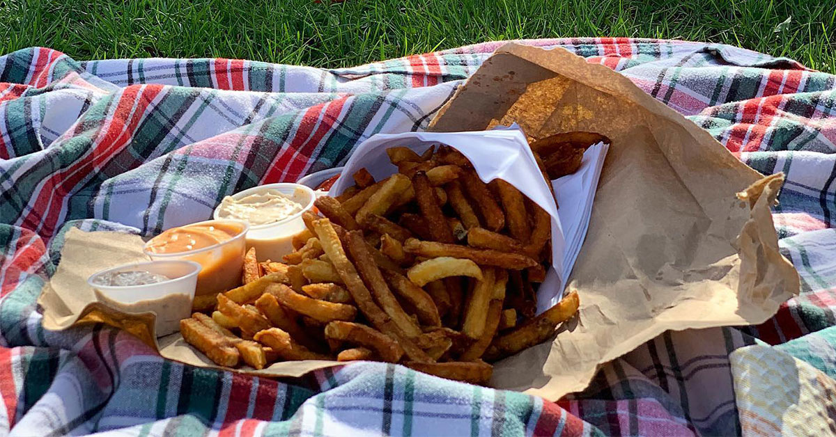 french fries on a picnic blanket