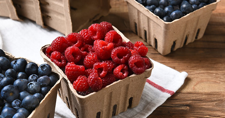 raspberries and blueberries in containers
