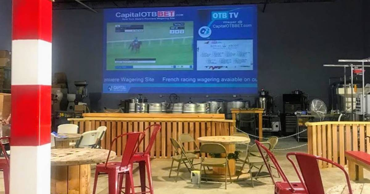 the track on a large projector screen, tables and chairs