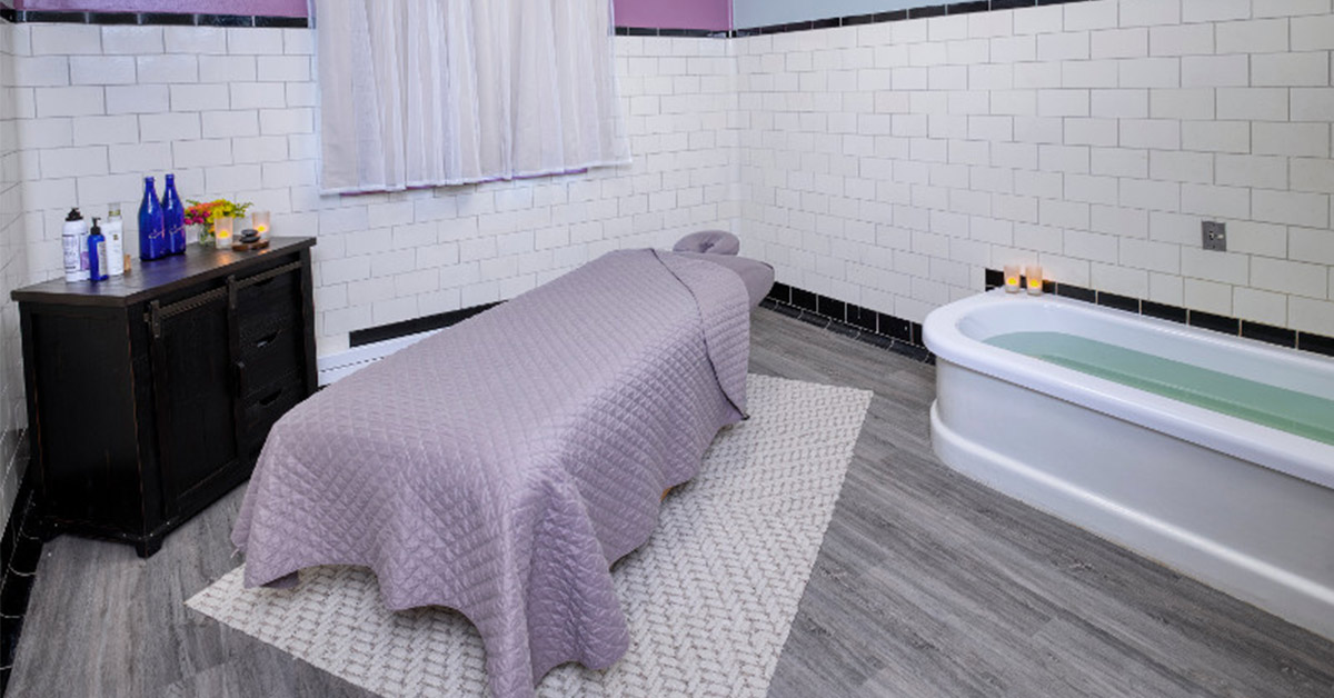 spa bed and tub in a room