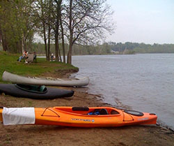 canoes and kayaks at the round lake preserve boat launch
