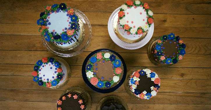 several cakes with floral designs