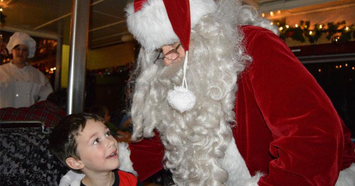 Santa looking down at a kid