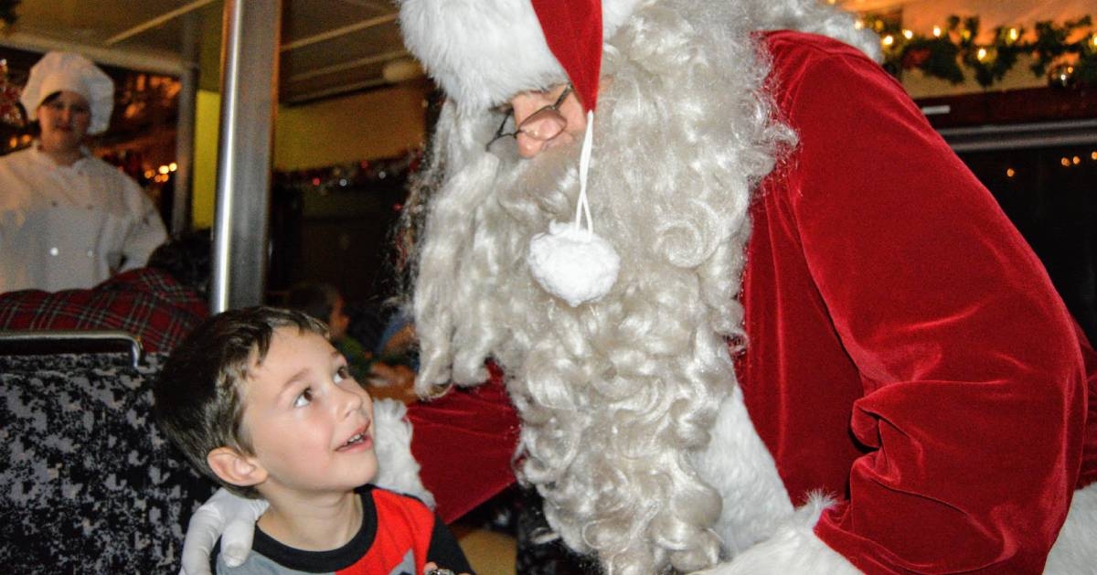 Santa looking down at a kid