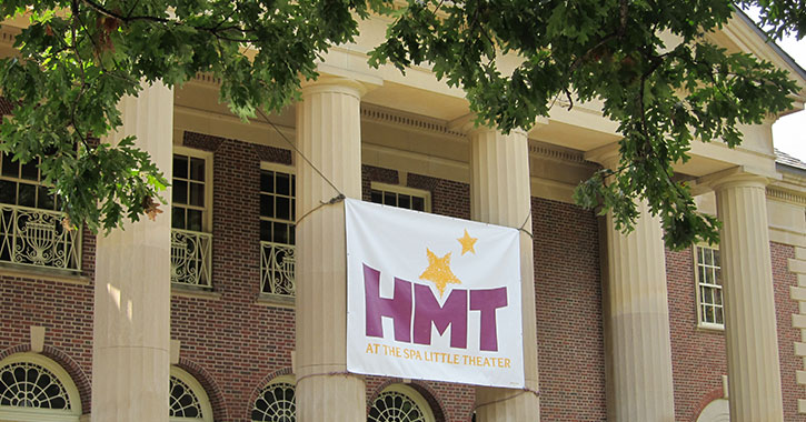 hmt banner in front of building
