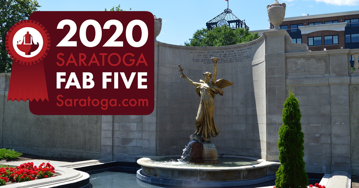monument in congress park with fab five badge