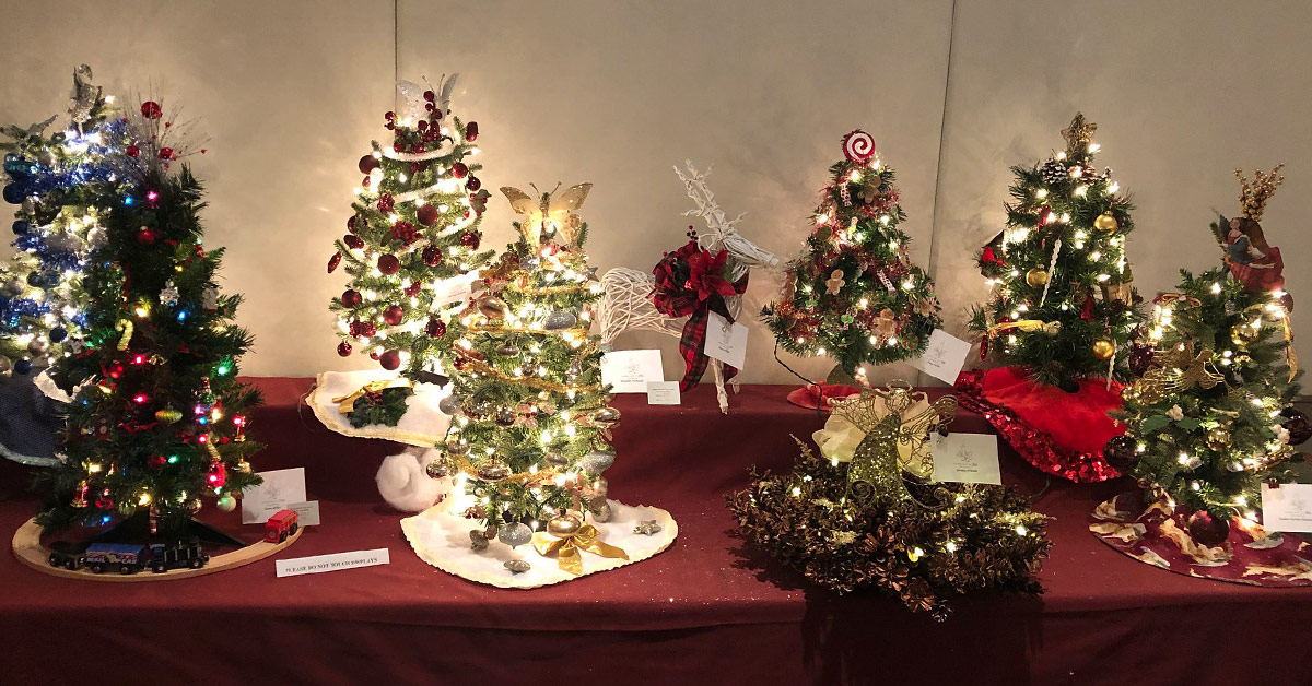 several small decorated trees on a table