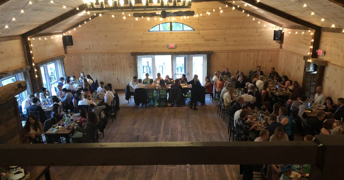 wedding reception in a rustic barn