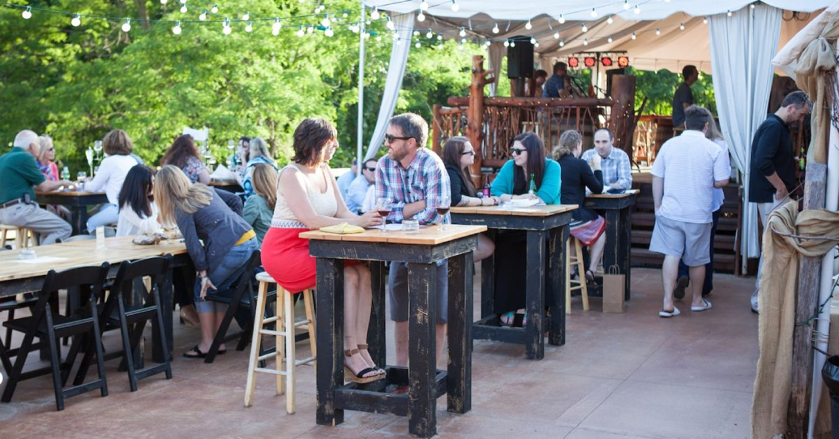 people at tables at a patio dining area