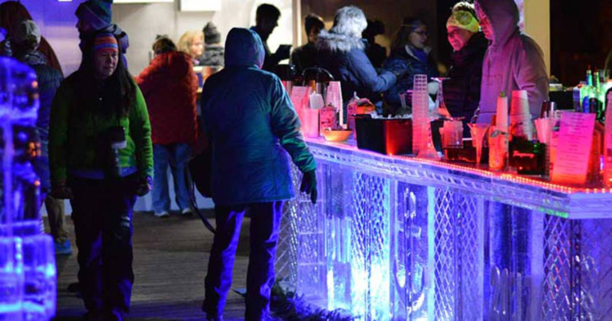 people at an outdoor ice bar