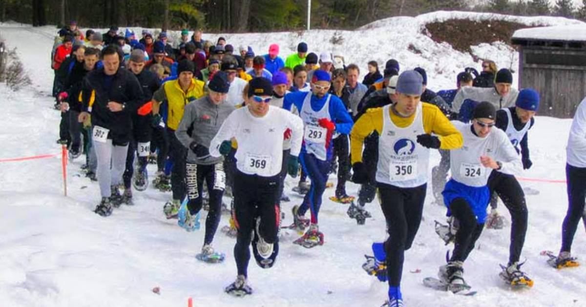 people in a snowshoe race