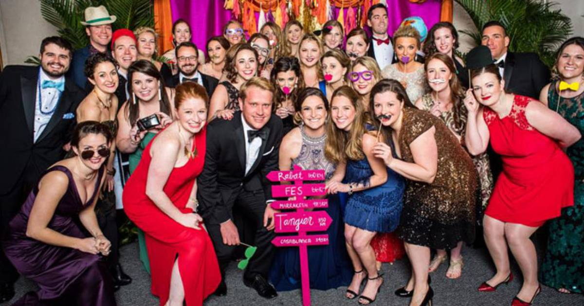 people dressed for a gala in a group photo