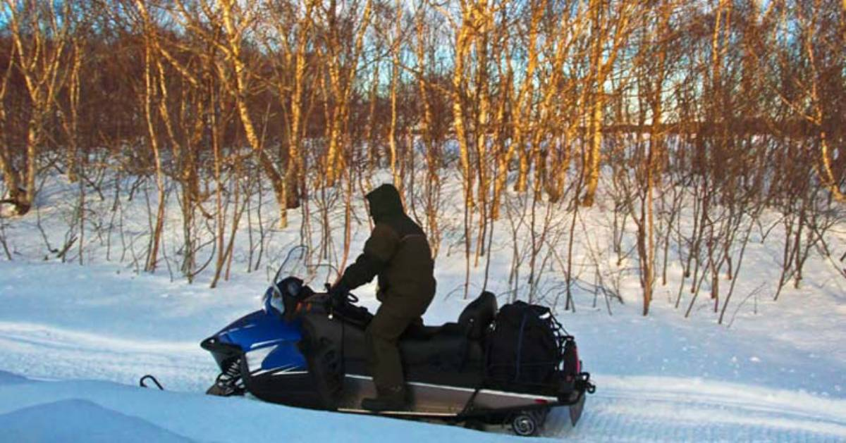 person on a snowmobile
