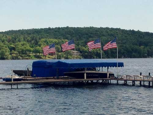 four american flags near boat dock