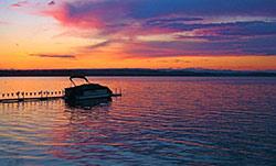 boat on saratoga lake during sunset