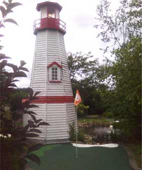 a lighthouse at one of the holes