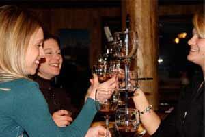 three women at a wine tasting having fun