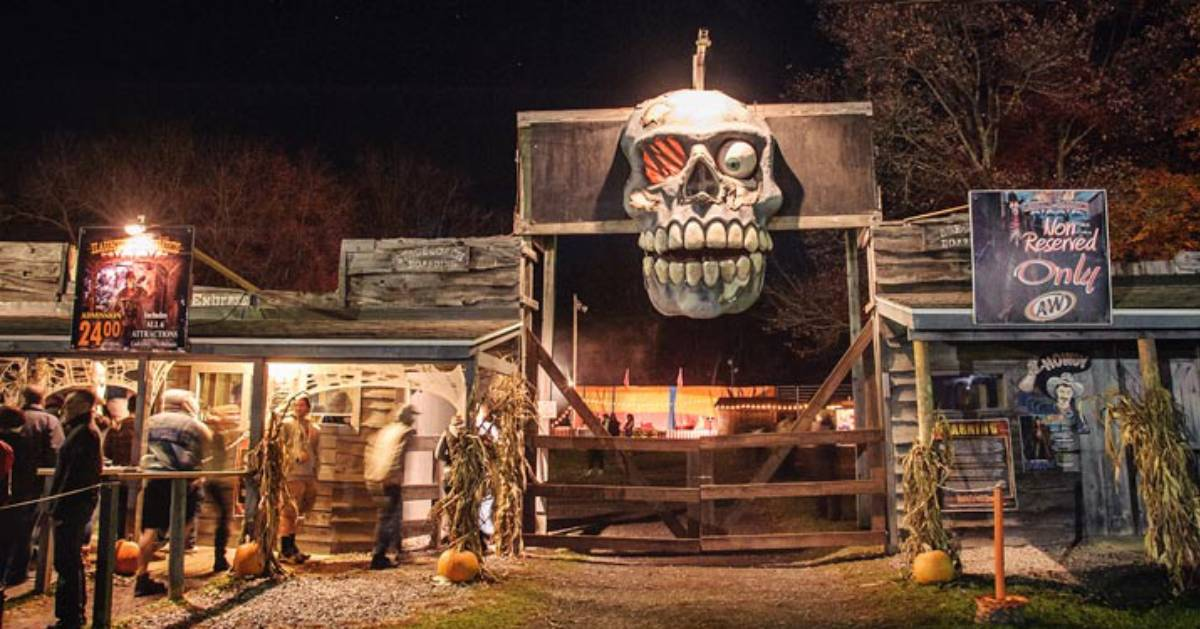 the opening entrance of Double M Haunted Hayrides with a giant skeleton head